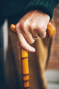 Close up of hand holding a cane