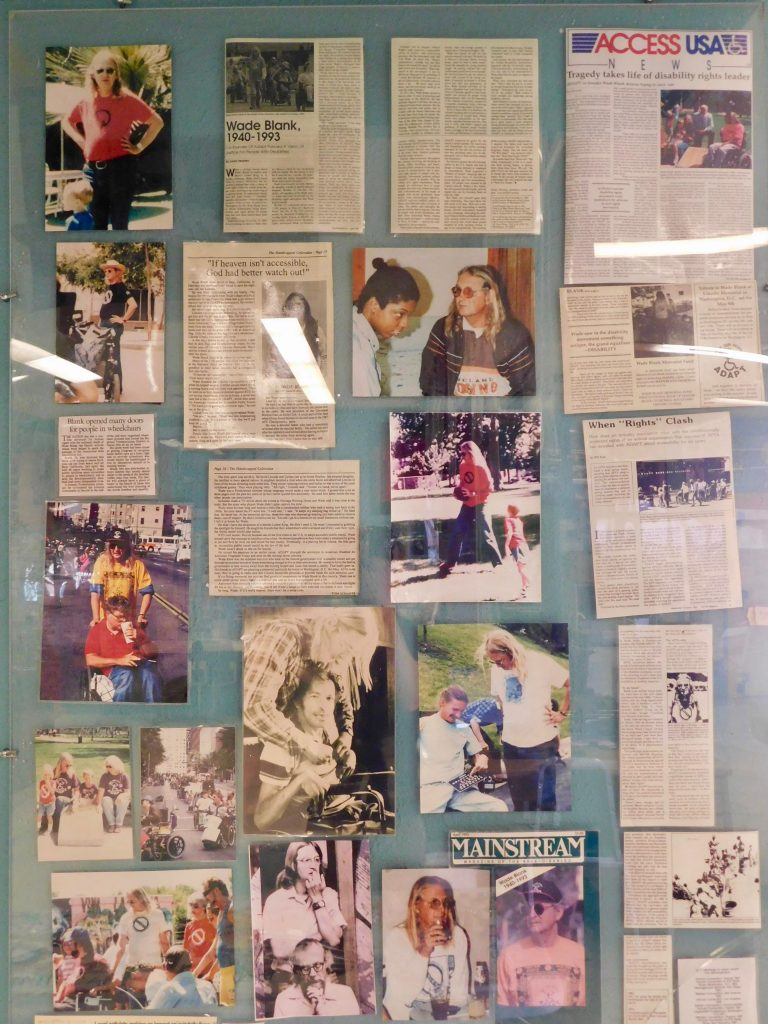 Panel with newspaper articles and photographs of Wade Blank in old Atlantis museum