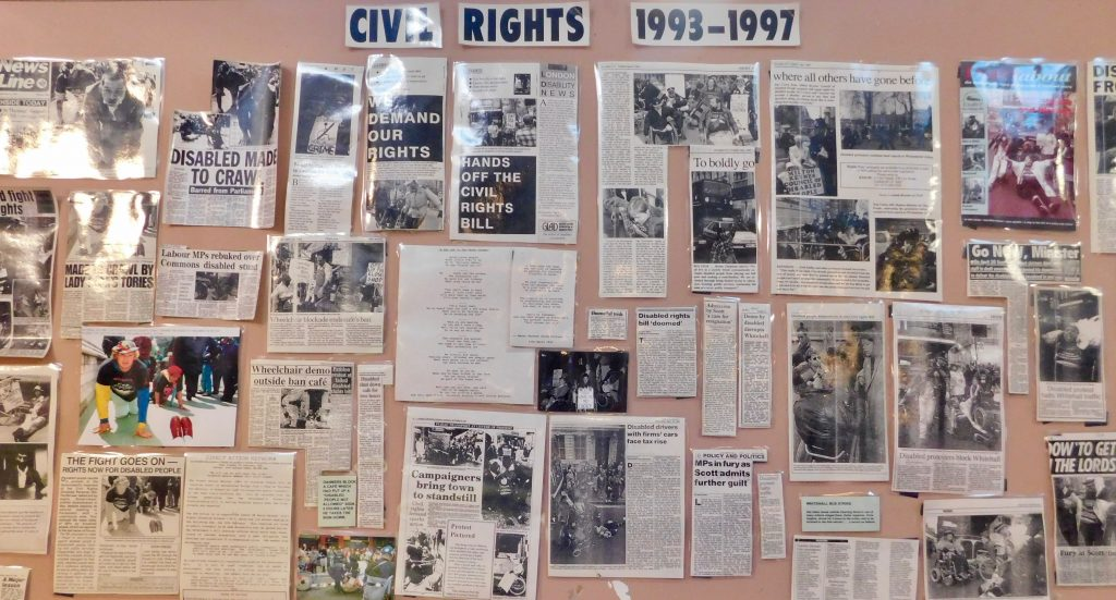Panel with newspaper articles and photographs of actions related to Civil Rights 1993-1997 in old Atlantis museum