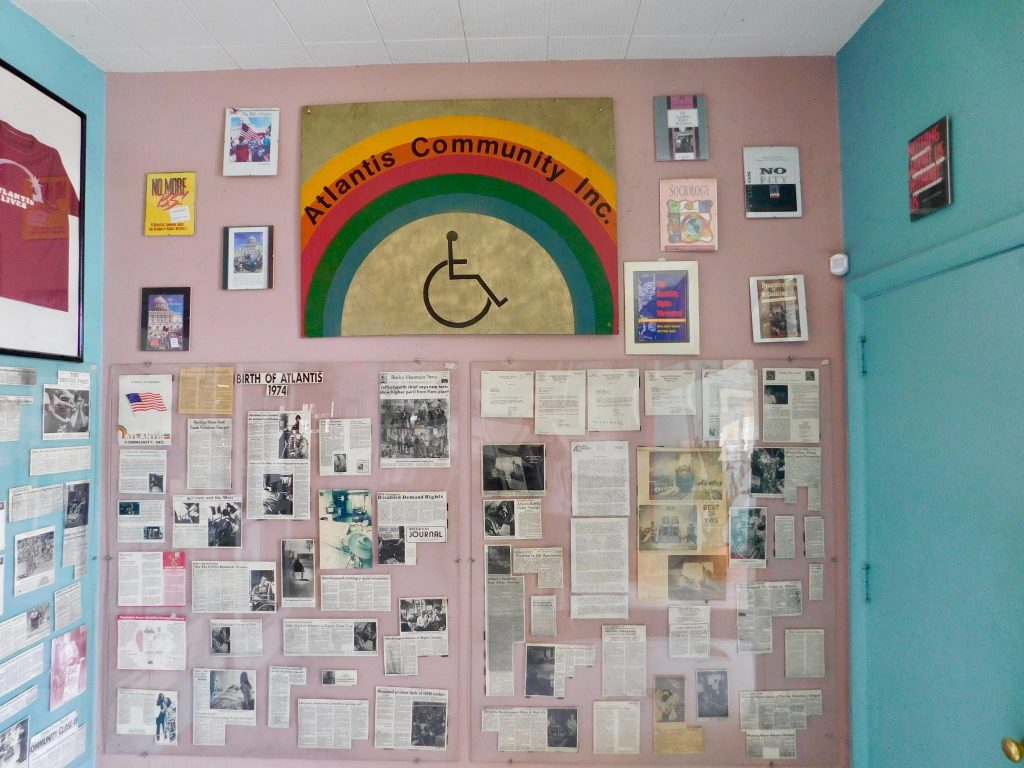 The old Atlantis building museum panels on the walls with photographs, articles, and community-made art