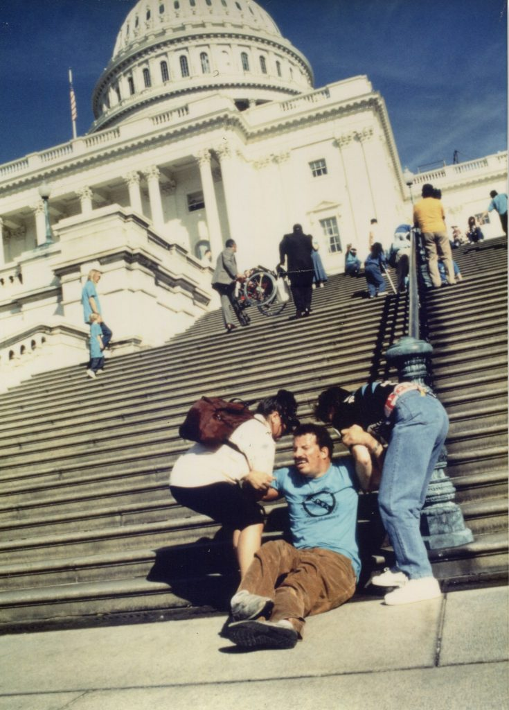 ADAPT member being carried up the Capitol steps in Washington, DC, to demonstrate for the passing of the ADA.