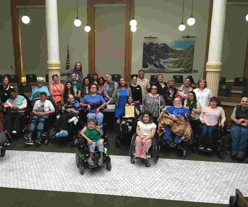 Photo of a large group of people at the state capitol